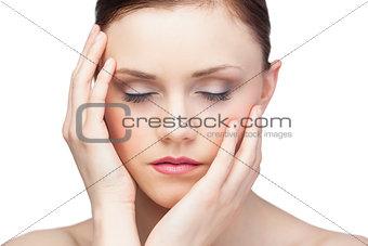 Thoughtful sensual brunette posing