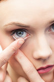 Cute model applying contact lens