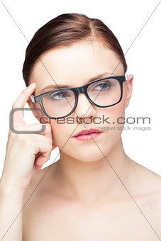 Thoughtful natural model wearing classy glasses