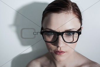Serious clean model with classy glasses posing