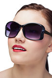Smiling sensual model wearing classy sunglasses