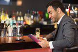 Attractive businessman sitting at bar
