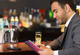 Close up of businessman sitting at bar