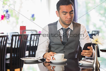Attractive businessman sitting in restaurant