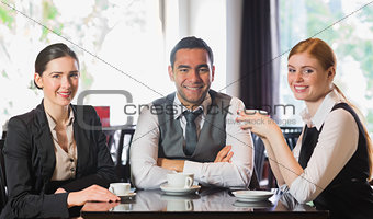 Business team having coffee together