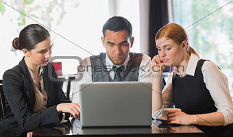 Business people working together with laptop