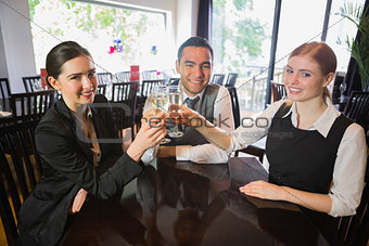 Business team celebrating a success with champagne in restaurant