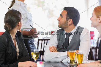 Business people talking to the waiter
