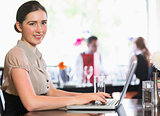 Attractive businesswoman working on laptop