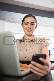 Happy businesswoman using phone