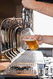 Bartender pulling a pint of beer