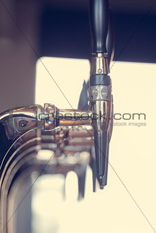 Silver beer taps close up