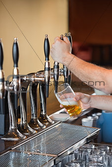 Barman pulling a pint of beer