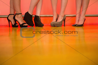 Womens legs wearing high heels
