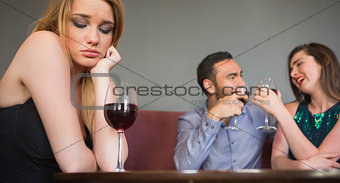 Blonde woman feeling envious of two people are flirting beside her