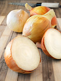 Onions on the rustic board.