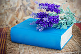 Book and lavender flowers