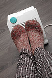 feet with wool socks and electric heater