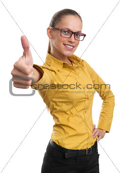 Beautiful smiling business woman showing thumb up sign