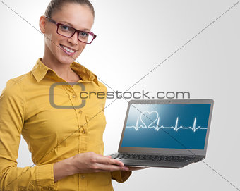 beautiful woman showing a laptop. Health care concept