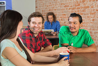 Man Drinking Coffee with Friends