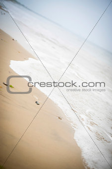 Tide coming in along the beach