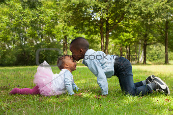 African boy is kissing his sister