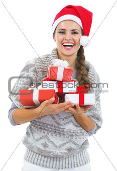 Portrait of happy young woman in sweater and christmas hat with