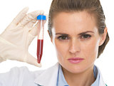 Doctor woman showing test tube
