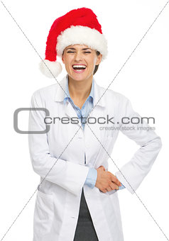 Portrait of smiling doctor woman in santa hat