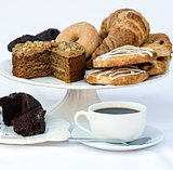Continental breakfast buffet table setting with coffee and pastr