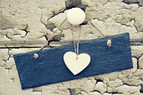 Macro retro cross processed effect image of hearts on wooden bac