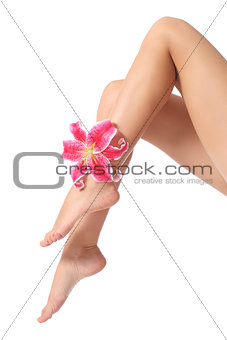 Beautiful smooth and waxed woman legs with a flower