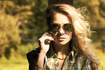 Portrait of Blonde Woman with Sunglasses