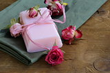 homemade soap with roses on a wooden table