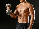 Asian man doing bicep curls