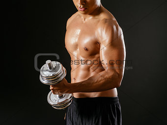 Asian man doing single bicep curl
