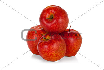Four red apples isolated on white background