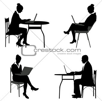 business people working on their laptops