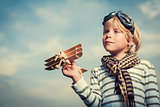 Boy with wooden plane
