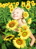 Young girl in the field of sunflowers