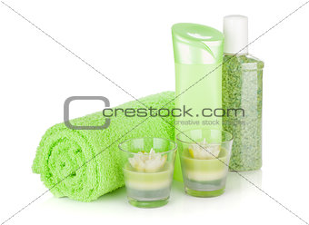 Bathroom bottles, towel and candles
