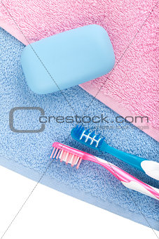 Toothbrushes and soap over towel