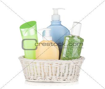 Cosmetics bottles in basket