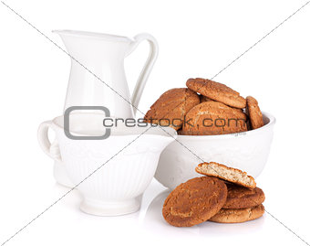 Bowl with cookies and milk
