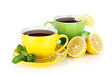 Two colorful cups of tea with lemon and mint