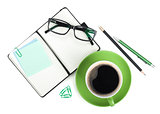 Coffee cup and office supplies
