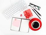 Red coffee cup, gift box and office supplies