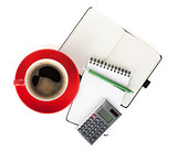 Red coffee cup and office supplies