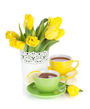 Yellow tulips and tea with lemon